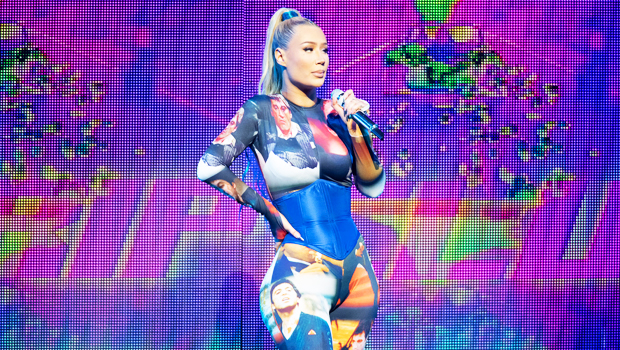 Iggy Azalea Wears A Bizarre CatsuitCovered With Faces Of Al Pacino ForPerformance